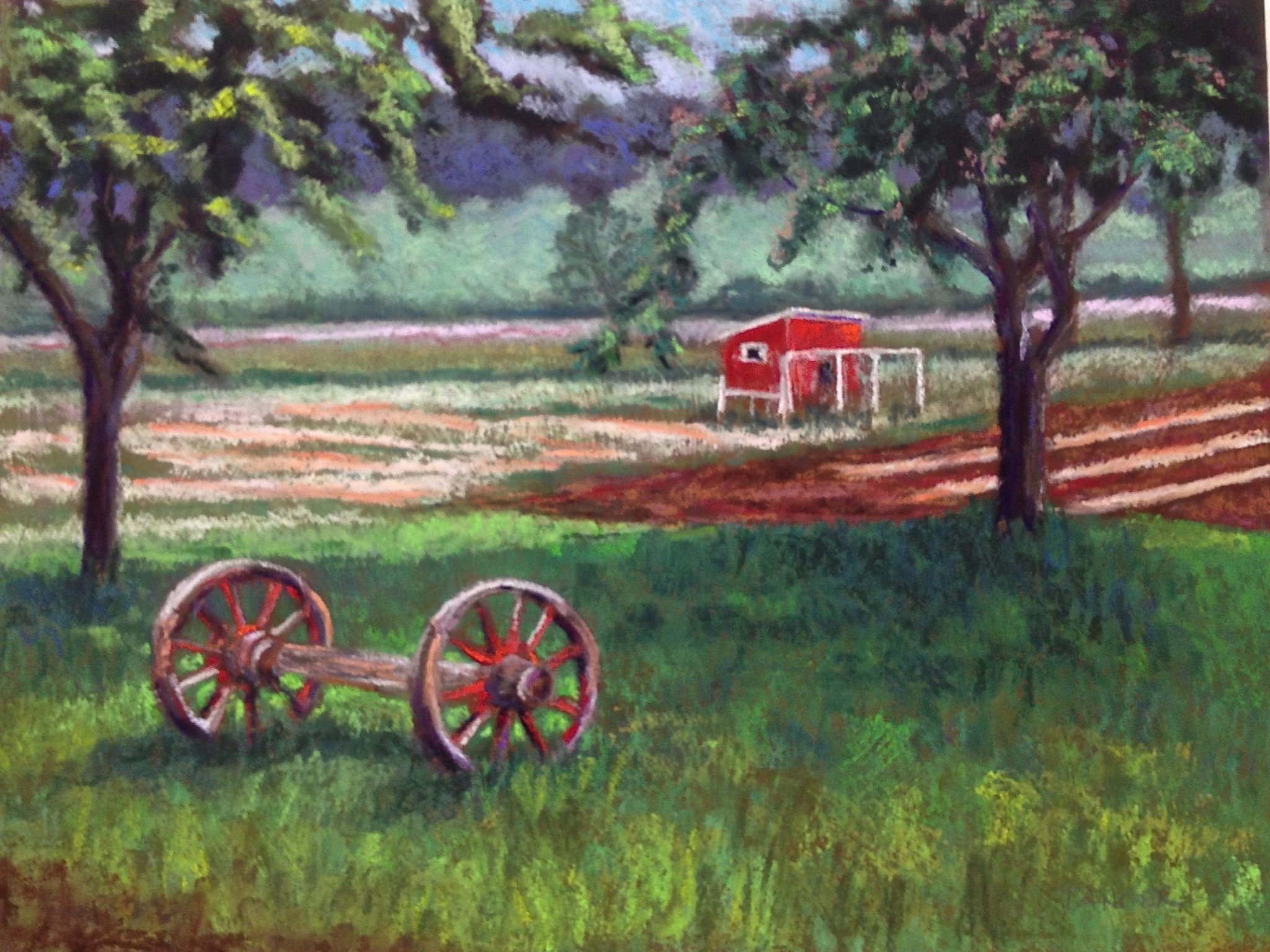 pastel of red hen house, wagon wheels and fields on a farm
