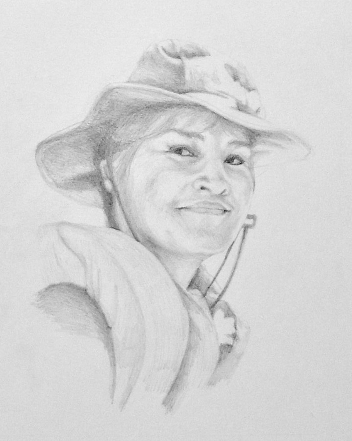 pencil sketch of young woman in a sun hat